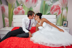Groom and  bride in a bedroom Royalty Free Stock Photography