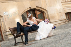 Groom and bride on bench Stock Photography