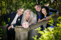 Groom, the bride and the best man with the witness in the park Royalty Free Stock Photography