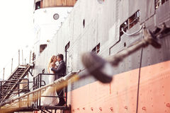 Groom and bride on a big ship Stock Photos