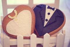 Groom and bride biscuits Stock Images