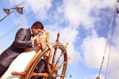 Groom and bride in a boat Stock Photography