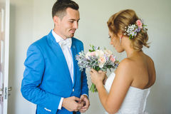 Groom and Bride with Bouquet. Groom looking at bride with wedding bouquet Stock Images