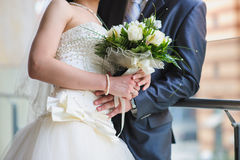 Groom and the bride with a bouquet Royalty Free Stock Images