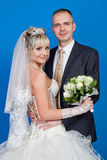Groom and bride with a bouquet from white roses in studio Stock Images