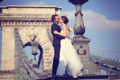 Groom and bride on a bridge Royalty Free Stock Image