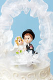 Groom and bride cake topper Royalty Free Stock Photos
