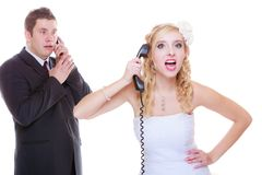Groom and bride calling to each other royalty free stock image