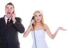 Groom and bride calling to each other stock photography