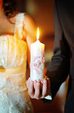 The groom and the bride with candles. Wedding ceremony in church Royalty Free Stock Image
