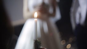The groom and the bride with candles. Wedding candles in the hands of the newlyweds stock video