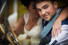 Groom and bride in car stock images