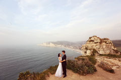Groom and bride on the cliffs of Normandy Royalty Free Stock Photo