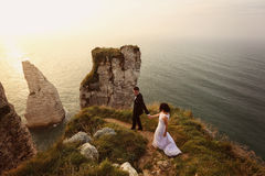 Groom and bride on the cliffs of Normandy Stock Images