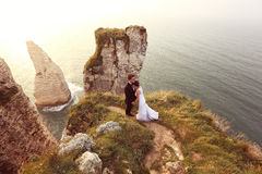 Groom and bride on the cliffs of Normandy Stock Photography