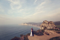Groom and bride on the cliffs of Normandy Royalty Free Stock Images