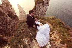 Groom and bride on the cliffs of Normandy Royalty Free Stock Photography