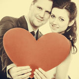 Groom and bride couple holding heart Royalty Free Stock Image