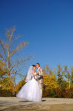 The groom and the bride dance on an autumn Royalty Free Stock Photo