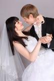 Groom and bride dance in studio stock photo
