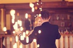 Groom and bride dancing Stock Image