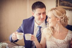 Groom, bride drink tea Royalty Free Stock Photos