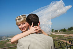 Groom and bride embracing outdoor Stock Photo