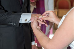 The groom and the bride exchange rings. Stock Photo