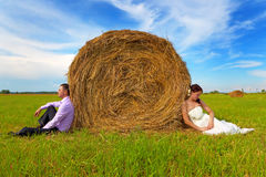 Groom and bride in the field Stock Photo