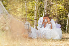 Groom and  bride in the forest on a bed Stock Photo