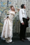 Groom and bride and a graffity wall Stock Photos