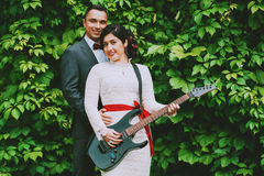 Groom and bride with guitar Royalty Free Stock Photos
