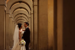 Groom and bride on a hallway Royalty Free Stock Photo