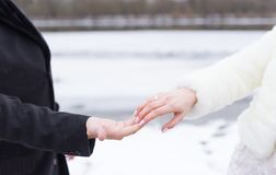 Groom and bride hands with rings. Groom and bride hand to hand in wintertime stock photography