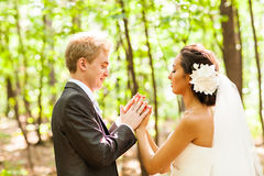 Groom and Bride have fun together  in a park Stock Photography