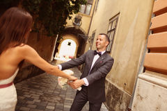 Groom and bride having fun in the city Stock Photography