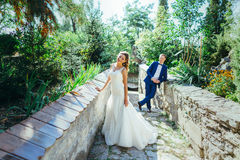 Groom and bride having fun in nature Royalty Free Stock Image