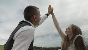 Groom with bride having a picnic on a mountain hills. Wedding couple. Family stock footage