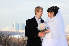 Groom and bride holding bouquet of roses Royalty Free Stock Photo