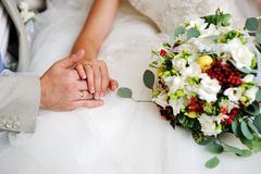 Groom and bride holding hands Stock Photo