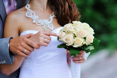 Groom and bride holding hands Stock Image
