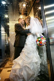 Groom and the bride in the hotel elevator Royalty Free Stock Images