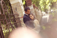 Groom and bride hugging each othere Stock Images