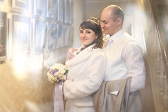 Groom and bride indoor Royalty Free Stock Photo