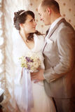 Groom and bride indoor Stock Photography