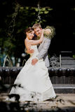 Groom and bride joy against backdrop fountain Royalty Free Stock Images