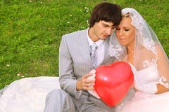 Groom and bride keep red balloon heart Stock Images