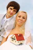 Groom and bride keep small house stock photography