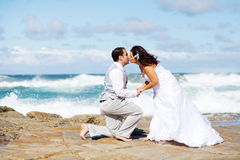 Groom and bride kissing Stock Photography