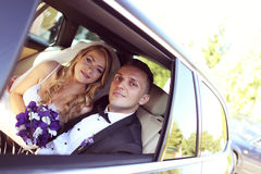 Groom and bride kissing in the car Royalty Free Stock Images